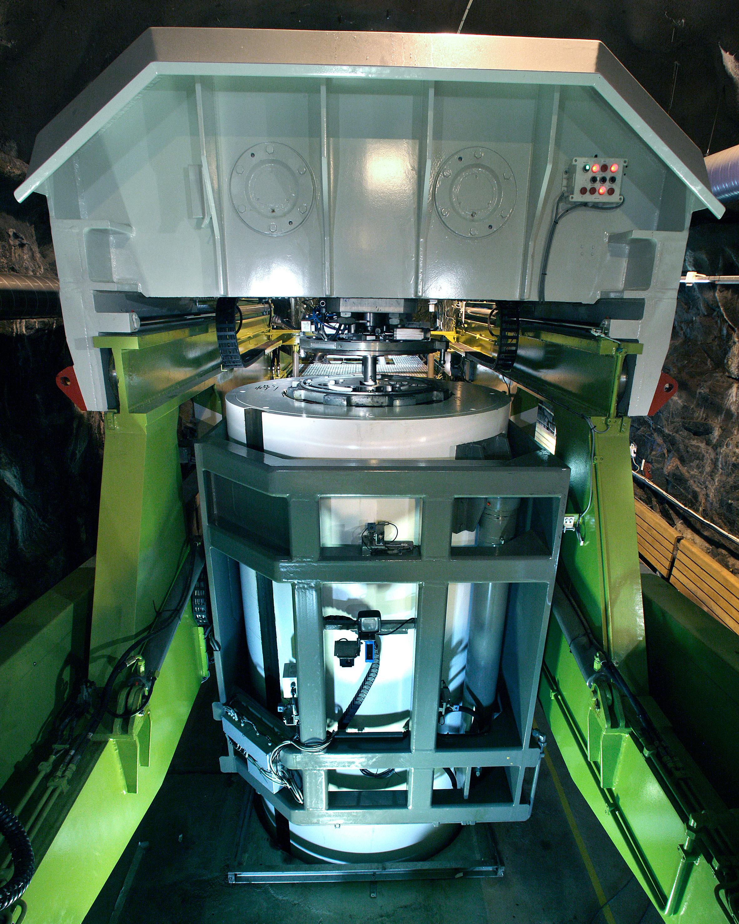 En maskin som deponerar kapslar.